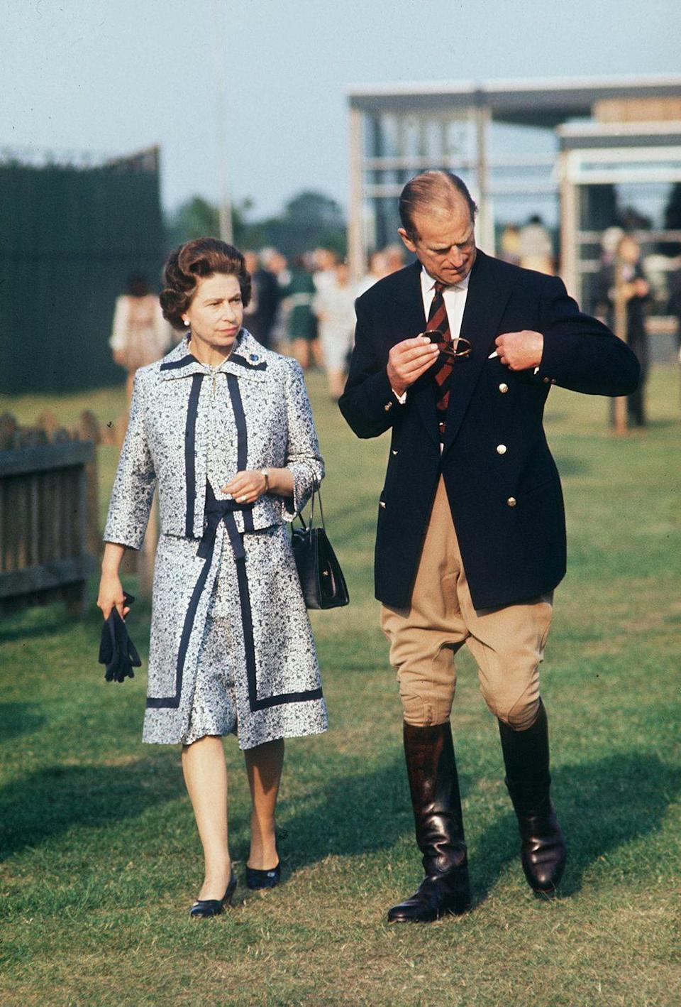 <p>In 1975, Prince Philip appeared at the Guards Polo Club wearing a double breasted navy topper fit for the sport. </p>