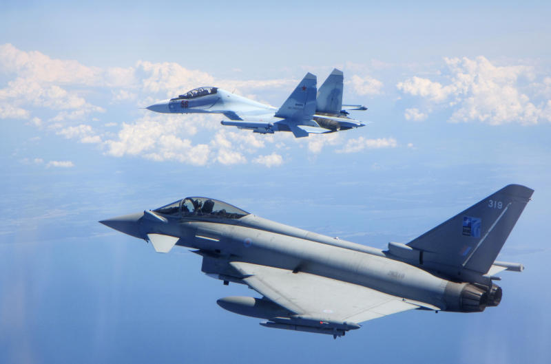 CAPTION CORRECTS AIRCRAFT NAME - In this photo  taken on Saturday, June 15, 2019, a Royal Air Force Typhoon jet, bottom, flies by a Su-30 Flanker fighter. Two Royal Air Force jets deployed in Estonia have been scrambled twice in recent days, bringing the number of intercepts of Russian aircraft to eight since taking over the Baltic Air Policing mission in early May. The Typhoon jets were alerted Friday to intercept a Russian Su-30 Flanker fighter, and passed a military transport craft as it was escorting the fighter over the Baltic Sea. In a second incident on Saturday, RAF crews intercepted a Su-30 Flanker fighter and an Ilyushin Il-76 Candid transport aircraft that was traveling north from the Russian enclave of Kaliningrad toward Estonian and Finnish airspace. (UK Ministry of Defence via AP)