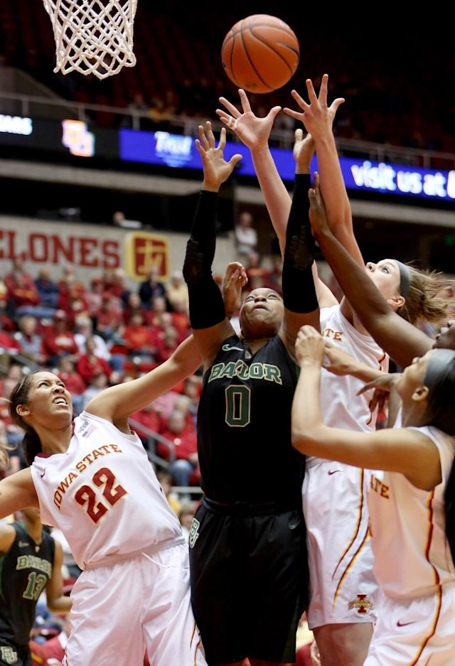 Baylor guard Odyssey Sims and Iowa State forwards Brynn Williamson (22) and Hallie Christofferson all reach for a rebound during the first half of an NCAA college basketball game in Ames, Iowa, Tuesday, March 4, 2014. (AP Photo/Justin Hayworth)