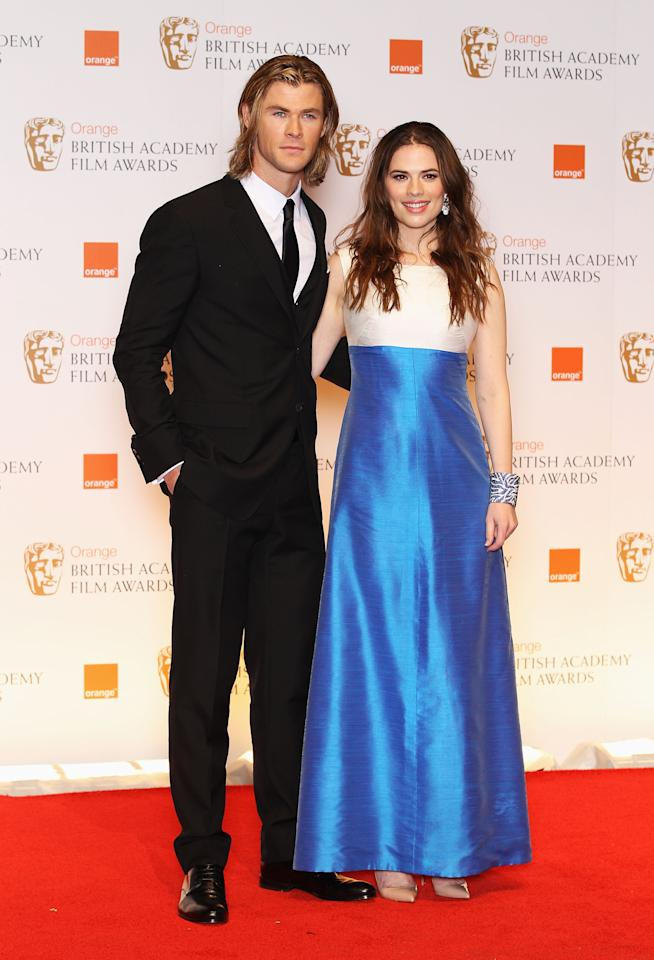 LONDON, ENGLAND - FEBRUARY 12: Presenters Chris Hemsworth (L) and Hayley Atwell pose in the press room during the Orange British Academy Film Awards 2012 at the Royal Opera House on February 12, 2012 in London, England.  (Photo by Chris Jackson/Getty Images)