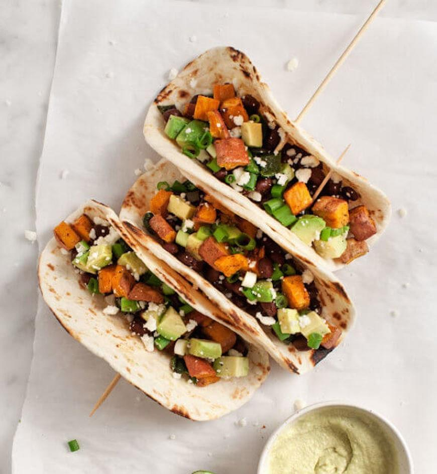 """<p>These are my personal all-time favorite vegetarian tacos; sweet potatoes, black beans, and avocado are already a great flavor combination, and it's even better wrapped in a warm, soft taco.</p> <p>Get the recipe <a href=""""https://www.loveandlemons.com/sweet-potato-avocado-tacos/"""" rel=""""nofollow noopener"""" target=""""_blank"""" data-ylk=""""slk:here"""" class=""""link rapid-noclick-resp"""">here</a>.</p>"""