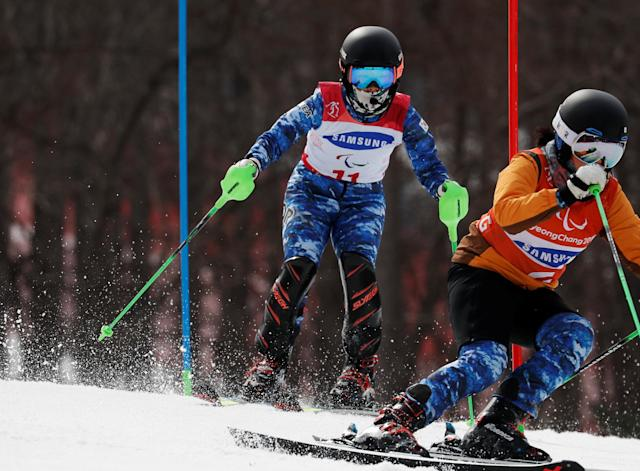 Alpine Skiing - Pyeongchang 2018 Winter Paralympics - Women's Slalom - Visually Impaired - Run 2 - Jeongseon Alpine Centre - Jeongseon, South Korea - March 18, 2018 - Yang Jae-rim of South Korea and her guide. REUTERS/Paul Hanna