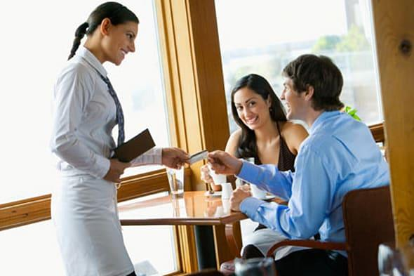Waitress accepting credit card from young couple in restaurantCreative image #:  76314221License type:  Royalty-freePhotograp