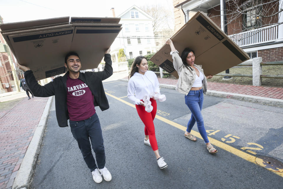 CAMBRIDGE, MA: March 10, 2020: Anthony O'Neil, Christian Cruz and Annie Wang prepare to pack as Harvard University announced it will close down their campus early this semester, asking students to vacate by March 15th over the Coronavirus, in Cambridge, Massachusetts. (Staff photo by Nicolaus Czarnecki/MediaNews Group/Boston Herald)