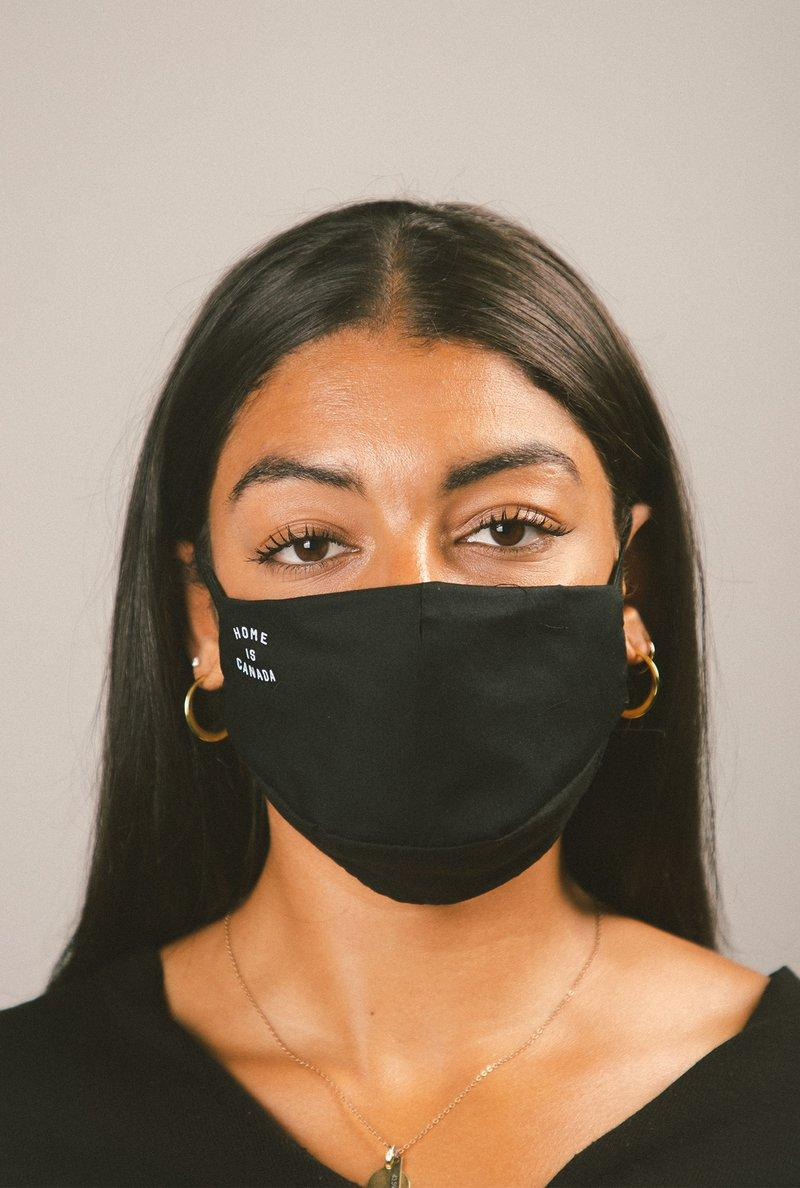 2 Pack Home is Canada Face Masks. Image via Peace Collective.