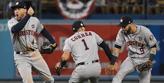 <p>Houston Astros left fielder Marwin Gonzalez (9) and shortstop Carlos Correa (1) and center fielder George Springer (4) celebrate after defeating the Los Angeles Dodgers in eleven innings in game two of the 2017 World Series at Dodger Stadium. Mandatory Credit: Richard Mackson-USA TODAY Sports </p>