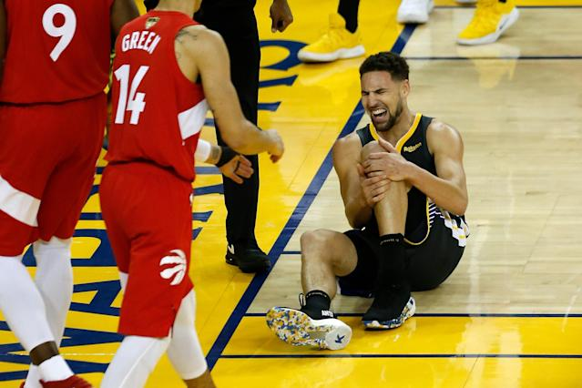 Klay Thompson of the Golden State Warriors reacts after injuring his knee during Game 6 of the NBA Finals. (Getty)
