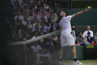 Canada's Denis Shapovalov serves to Serbia's Novak Djokovic during the men's singles semifinals match on day eleven of the Wimbledon Tennis Championships in London, Friday, July 9, 2021. (AP Photo/Alberto Pezzali)