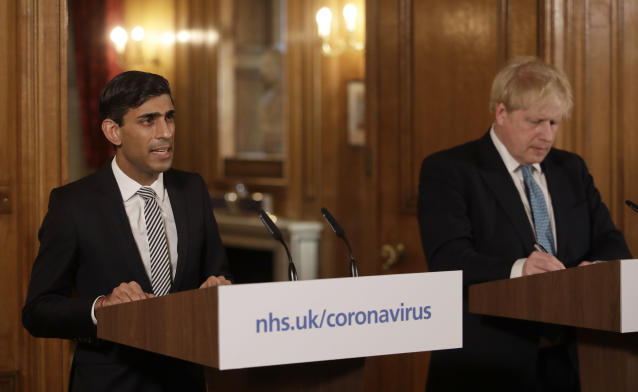 Britain's Chancellor Rishi Sunak, (L) and British Prime Minister Boris Johnson give a press conference about the ongoing situation with the coronavirus (COVID-19) outbreak. (Photo by Matt Dunham/Getty Images)
