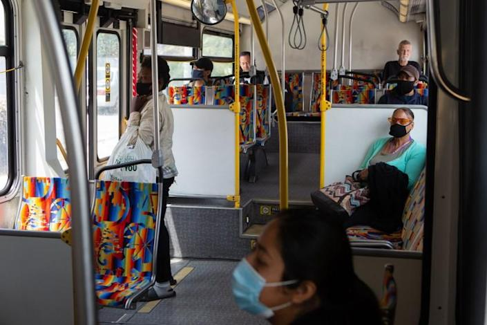 "People ride the westbound 33 bus toward Venice in downtown Los Angeles on April 19. <span class=""copyright"">(Los Angeles Times)</span>"