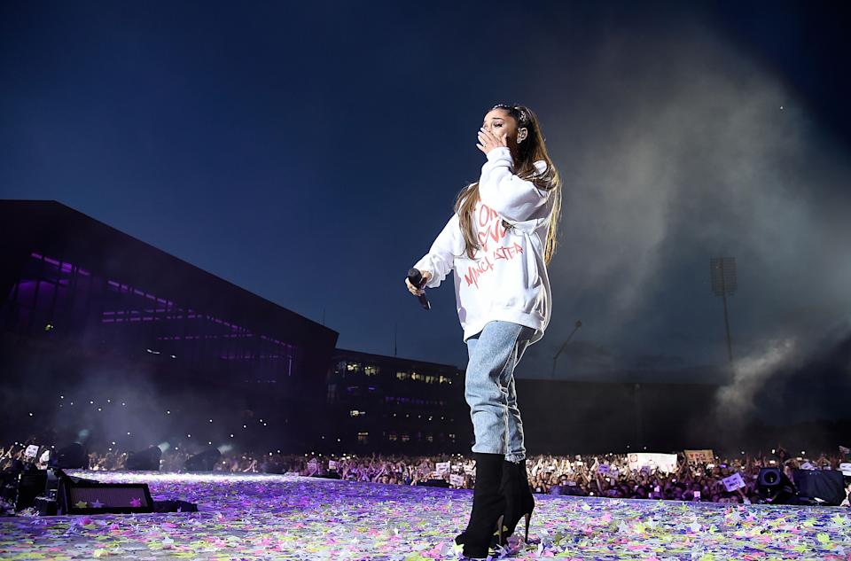 MANCHESTER, ENGLAND - JUNE 04:  Ariana Grande wipes away a tear as she performs on stage during the One Love Manchester Benefit Concert at Old Trafford Cricket Ground on June 4, 2017 in Manchester, England.  (Photo by Kevin Mazur/One Love Manchester/Getty Images for One Love Manchester)