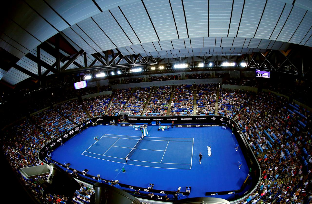FILE PHOTO: France's Jo-Wilfried Tsonga serves during his third round match against compatriot Pierre-Hugues Herbert, with the roof closed at Margaret Court Arena, at the Australian Open tennis tournament at Melbourne Park, Australia, January 22, 2016. REUTERS/Jason O'Brien/File Photo