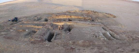 Archaeologists discovered the remains of a toddler in Romano-Christian-period cemetery in Dakhleh Oasis, Egypt, who showed evidence of child abuse. Here, mud bricks for two tomb structures in the cemetery. In the foreground, several excavated g