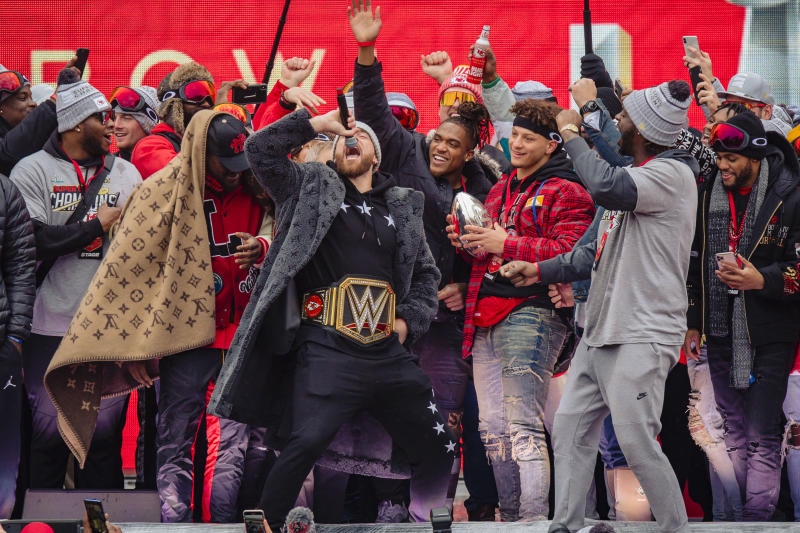 Travis Kelce (center, with WWE championship belt) and the Chiefs are a confident team heading into the 2020 season. This may ultimately cast them as NFL villains, but Kelce says they're ready for the challenge. (Photo by Kyle Rivas/Getty Images)