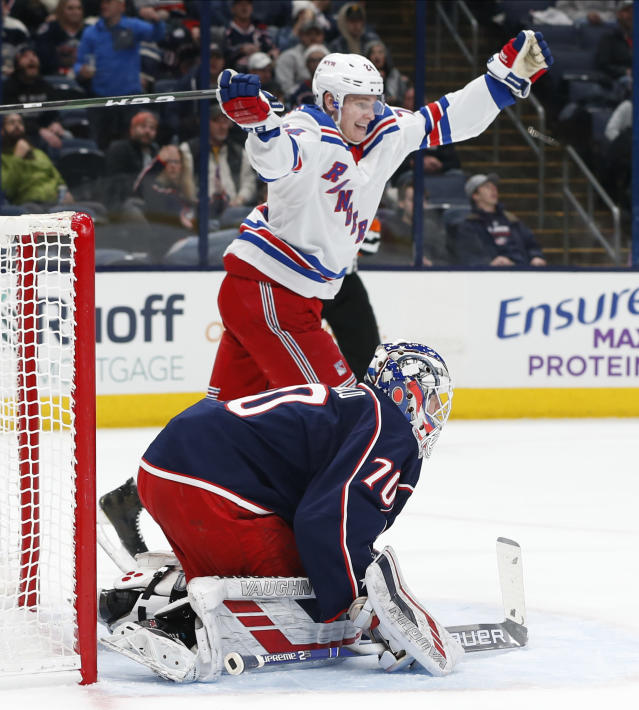 New York Rangers' Kaapo Kakko, top, of Finland, celebrates a Rangers goal against Columbus Blue Jackets' Joonas Korpisalo, of Finland, during the first period of an NHL hockey game Thursday, Dec. 5, 2019, in Columbus, Ohio. (AP Photo/Jay LaPrete)