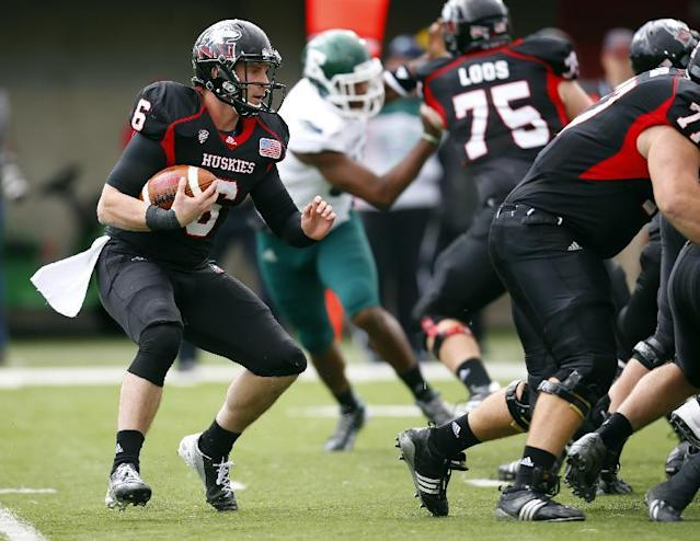 Northern Illinois quarterback Jordan Lynch (6) runs against Eastern Michigan during the first half of an NCAA college football game on Saturday, Oct. 26, 2013, in DeKalb, Ill. (AP Photo/Jeff Haynes)