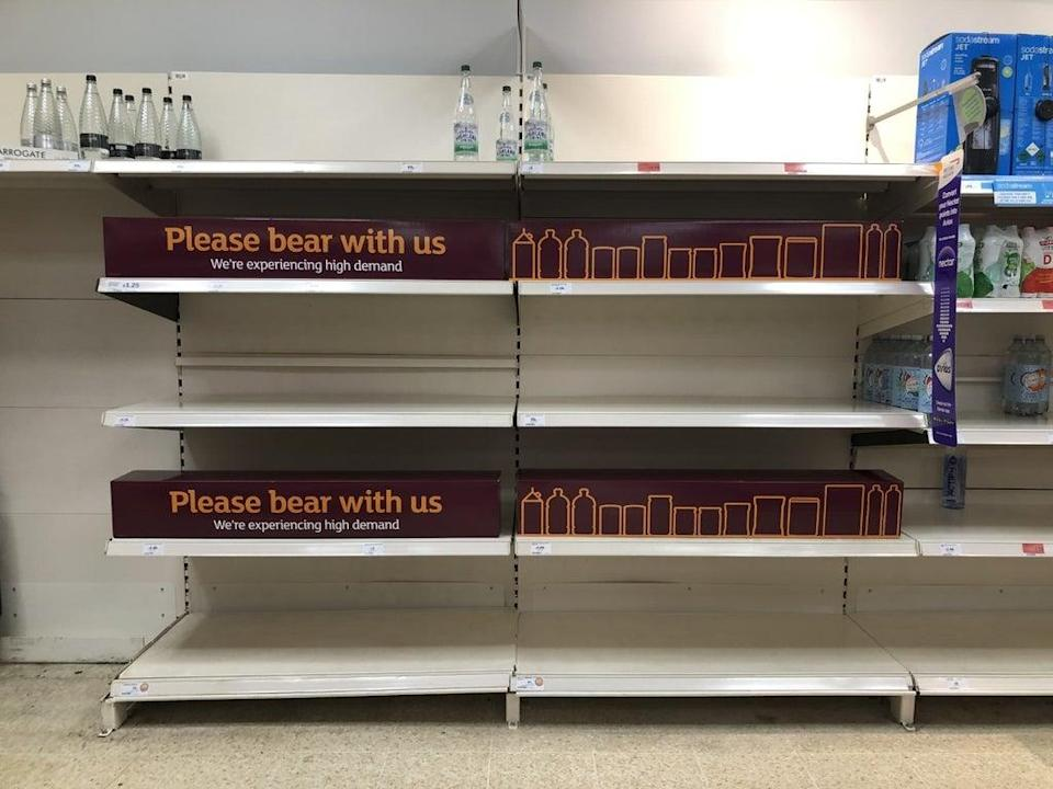 Empty shelves and signs on the soft drinks aisle of a Sainsbury's store in Blackheath, Rowley Regis in the West Midlands. (PA Wire)