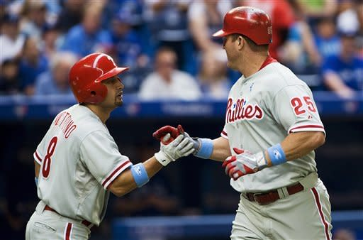 Philadelphia Phillies' Jim Thome, right, celebrates a home run with Shane Victorino against the Toronto Blue Jays during the second inning of a baseball game, Sunday, June 17, 2012, in Toronto. (AP Photo/The Canadian Press, Aaron Vincent Elkaim)