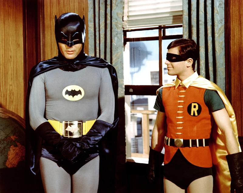 Batman, the Movie, 1966 Costume Designer: Pat Barto Long before the molded plastic and seriousness of the modern incarnation, the caped crusader did all his fighting in spandex. In the '60s, Adam West's Batman film relied heavily on a gray knit suit and the punchy wardrobes of its many villains. You weren't a real threat to Gotham if you didn't have a splashy getup. Decades later and audiences still recognize the Joker's clown makeup, Riddler's acid green question marks, and Catwoman's glittering catsuit.