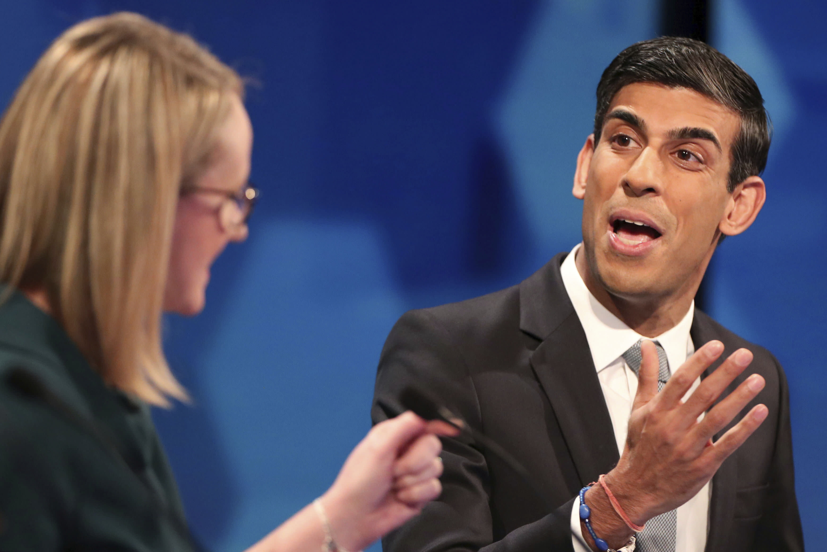 Conservatives' Chief Secretary to the Treasury Rishi Sunak, right and Labour's shadow business secretary Rebecca Long Bailey speak, during a general election debate in Cardiff, Wales, Friday, Nov. 29, 2019. (Hannah McKay/Pool Photo via AP)