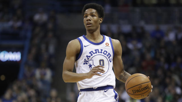 "Warriors guard <a class=""link rapid-noclick-resp"" href=""/nba/players/5669/"" data-ylk=""slk:Patrick McCaw"">Patrick McCaw</a> took a hard fall on Saturday against the Kings and had to be stretchered off the court. (AP)"