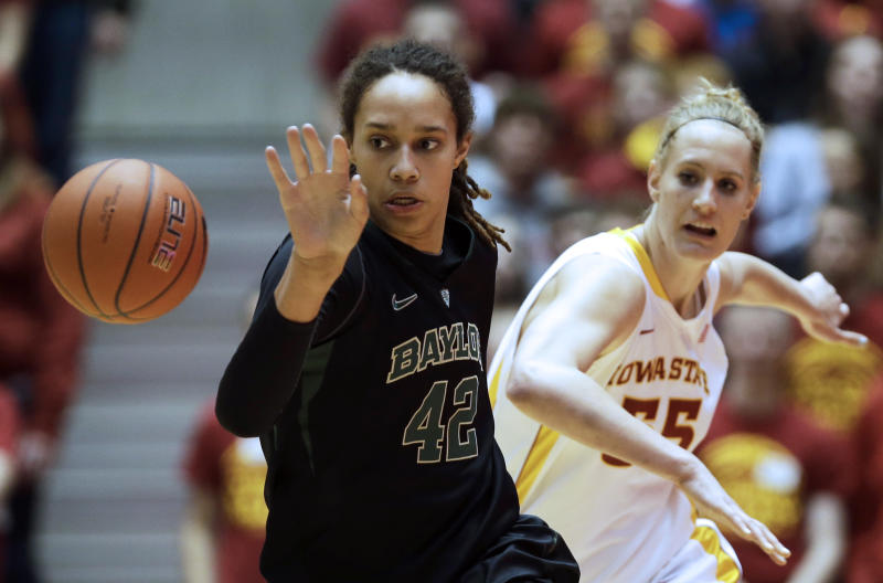 Baylor center Brittney Griner, left, runs down a loose ball ahead of Iowa State center Anna Prins during the first half of an NCAA college basketball game, Wednesday, Jan. 23, 2013, in Ames, Iowa. (AP Photo/Charlie Neibergall)