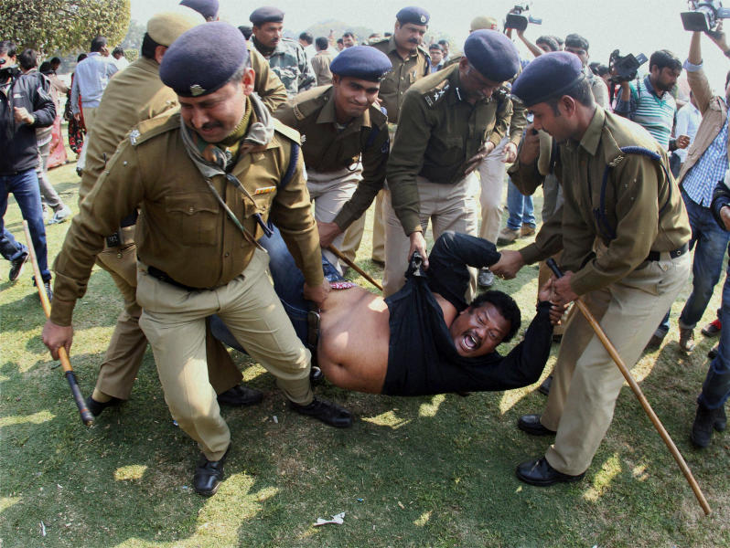 Indian policemen detain a supporter of the creation of a separate state of Telangana out of existing Andhra Pradesh state as he shouts slogans during a protest outside Vijay Chowk square in New Delhi, India, Thursday, Feb. 13, 2014. Congress party lawmaker L. Rajagopal from Andhra Pradesh sprayed pepper spray inside India's Parliament on Thursday from the main speaking zone, creating chaos that left his colleagues coughing and crying as they were ushered from the hall, in a protest over a long-contentious proposal to create a new southern state. (AP Photo)