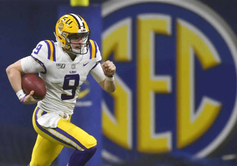 FILE - In this Dec. 7, 2019, file photo, LSU quarterback Joe Burrow (9) runs against Georgia during the second half of the Southeastern Conference championship NCAA college football game, in Atlanta. Burrow is a hero on LSU's Baton Rouge campus, but he hasn't seen much of it because he took graduate courses online. (AP Photo/Mike Stewart, File)