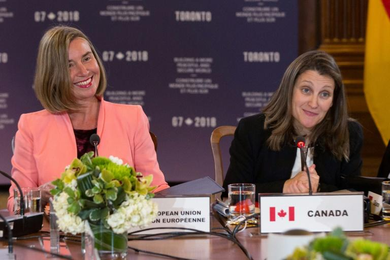 Canadian Foreign Minister Chrystia Freeland (L) and the EU High Representative for Foreign Affairs and Security Policy, Federica Mogherini, opened a meeting of G7 ministers with a tribute to their female counterparts around the world