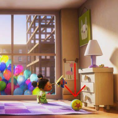 """<p>The """"Luxo Ball"""" — a yellow ball with a blue stripe and a red star — is another symbol of early Pixar that has made its way into multiple movies. It's a reference to <a href=""""https://www.youtube.com/watch?v=6G3O60o5U7w"""" rel=""""nofollow noopener"""" target=""""_blank"""" data-ylk=""""slk:one of Pixar's first computer-animated shorts"""" class=""""link rapid-noclick-resp"""">one of Pixar's first computer-animated shorts</a>, called """"<a href=""""https://ohmy.disney.com/movies/2014/10/16/chronicles-of-the-luxo-ball/"""" rel=""""nofollow noopener"""" target=""""_blank"""" data-ylk=""""slk:Luxo, Jr."""" class=""""link rapid-noclick-resp"""">Luxo, Jr.</a>"""" Now, the ball can be found in the playrooms of the <em>Toy Story </em>movies, in Boo's bedroom in<em> Monster's Inc.</em>, and in this little girl's room in <em>Up</em>, among others. </p>"""