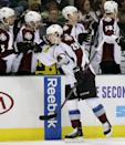 Colorado Avalanche center Nathan MacKinnon (29) is congratulated by the bench after scoring against the Dallas Stars in the first period of an NHL hockey game, Monday, Jan. 27, 2014, in Dallas. (AP Photo/Tony Gutierrez)