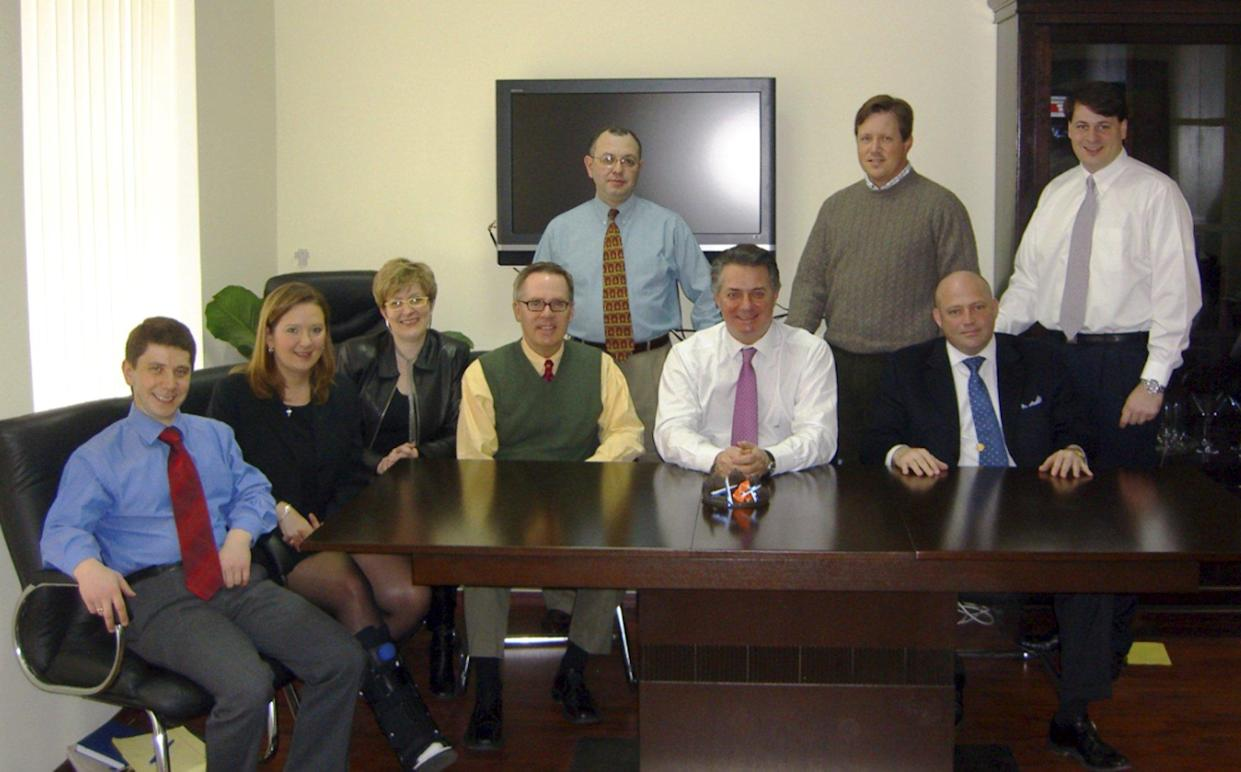 """<span class=""""s1"""">Konstantin Kilimnik is seated at far left in a 2006 photo obtained by the Associated Press as part of a collection of memos and business records from Manafort's international political consulting offices. (Photo: AP)</span>"""