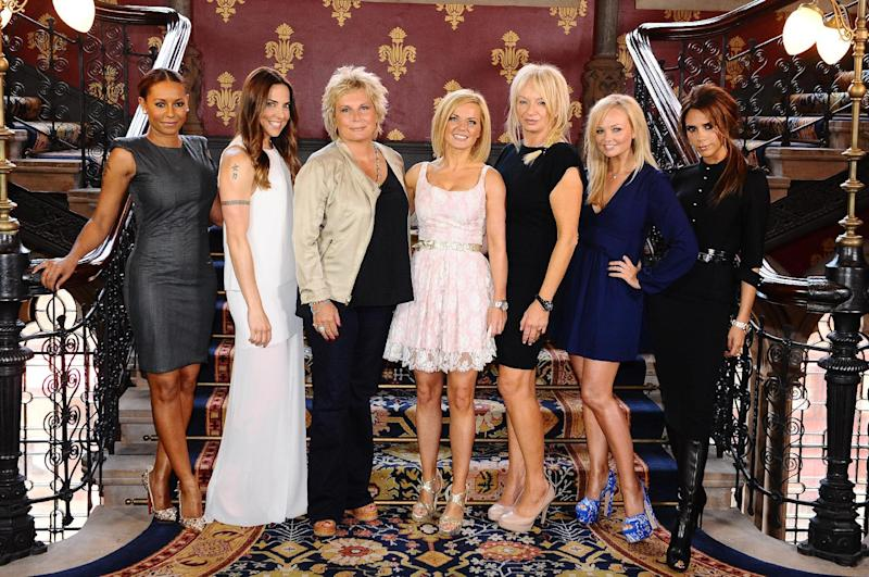 Scriptwriter Jennifer Saunders, third from left, and producer Judy Craymer, third from right, pose with the Spice Girls, from left Melanie Brown, Melanie Chisholm, Geri Halliwell, Emma Bunton and Victoria Beckham during a photo call at a central London hotel, Tuesday June 26, 2012, to launch Viva Forever, a musical featuring songs from the Spice Girls, which will open on 11th December 2012. (AP Photo/PA, Ian West) UNITED KINGDOM OUT NO SALES NO ARCHIVE