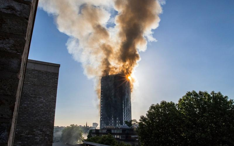 Smoke billows from a fire that has engulfed the 27-storey Grenfell Tower in west London - PA