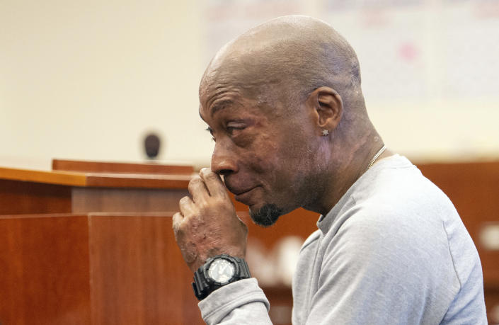 FILE - In this Aug. 10, 2018 file photo, Dewayne Johnson reacts after hearing the verdict in his case against Monsanto at the Superior Court of California in San Francisco. A Northern California groundskeeper says he will accept a judge's reduced verdict of $78 million against Monsanto after a jury found the company's weed killer caused his cancer. DeWayne Johnson's attorney informed the San Francisco Superior Court on Wednesday, Oct. 31, 2018. (Josh Edelson/Pool Photo via AP, File)