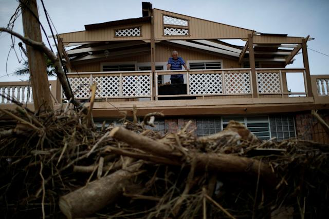 A man looks at the damages to his house after the area was hit by Hurricane Maria in Toa Baja, Puerto Rico.