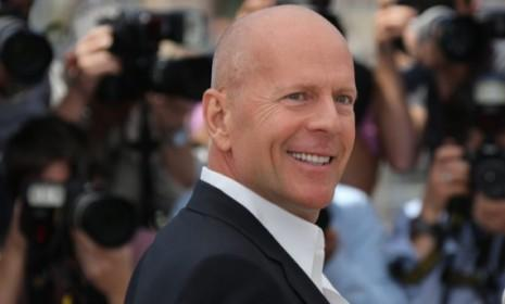 Being bald, as opposed to having thin hair, is perceived to be more masculine thanks to Hollywood alpha males like Bruce Willis.