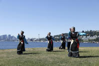 Members of a Seattle Tibetan Choelsum Bhumo dance group record a video for an upcoming virtual festival in the morning during a heat wave hitting the Pacific Northwest, Sunday, June 27, 2021, in Seattle. Yesterday set a record high for the day with more record highs expected today and Monday. (AP Photo/John Froschauer)