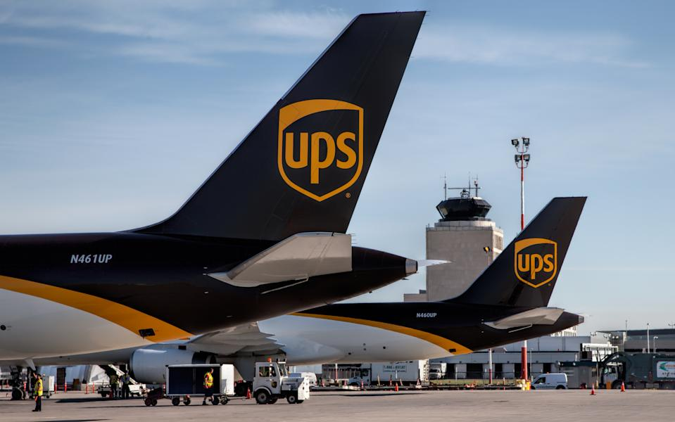 Winnipeg, Canada – July 20, 2016: Two UPS Boeing-757 Cargo Freighters sit on the ramp at Winnipeg James Armstrong Richardson International Airport with the Air Traffic Control Tower in the background