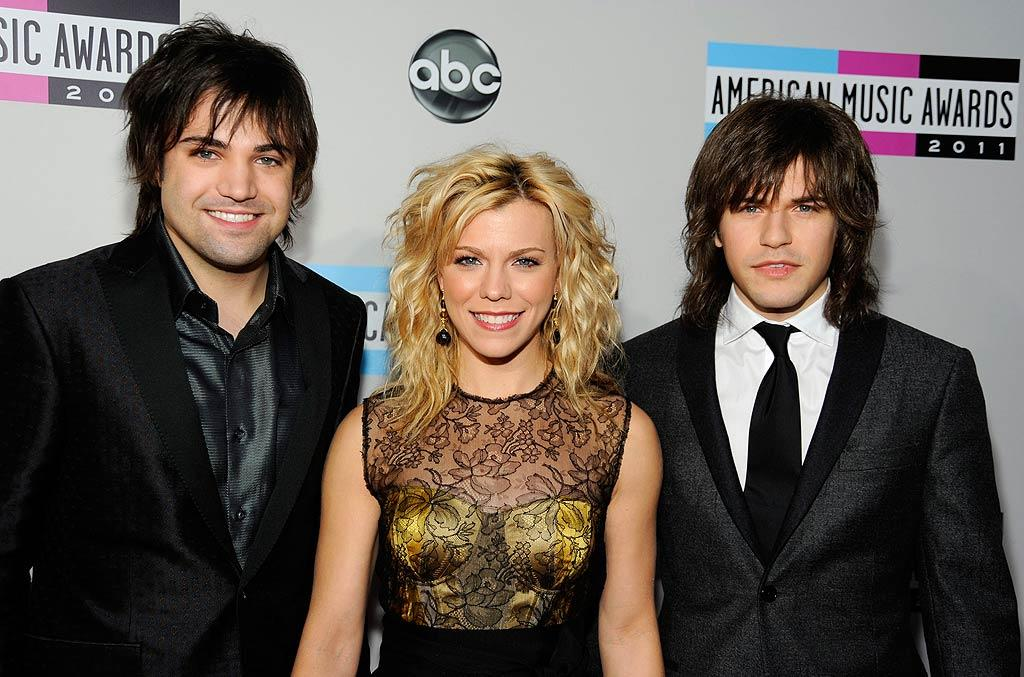 The Band Perry, consisting of siblings Neil, Kimberly Perry, and Reid, arrives at the 2011 American Music Awards held at Nokia Theatre L.A. LIVE. (11/20/2011)