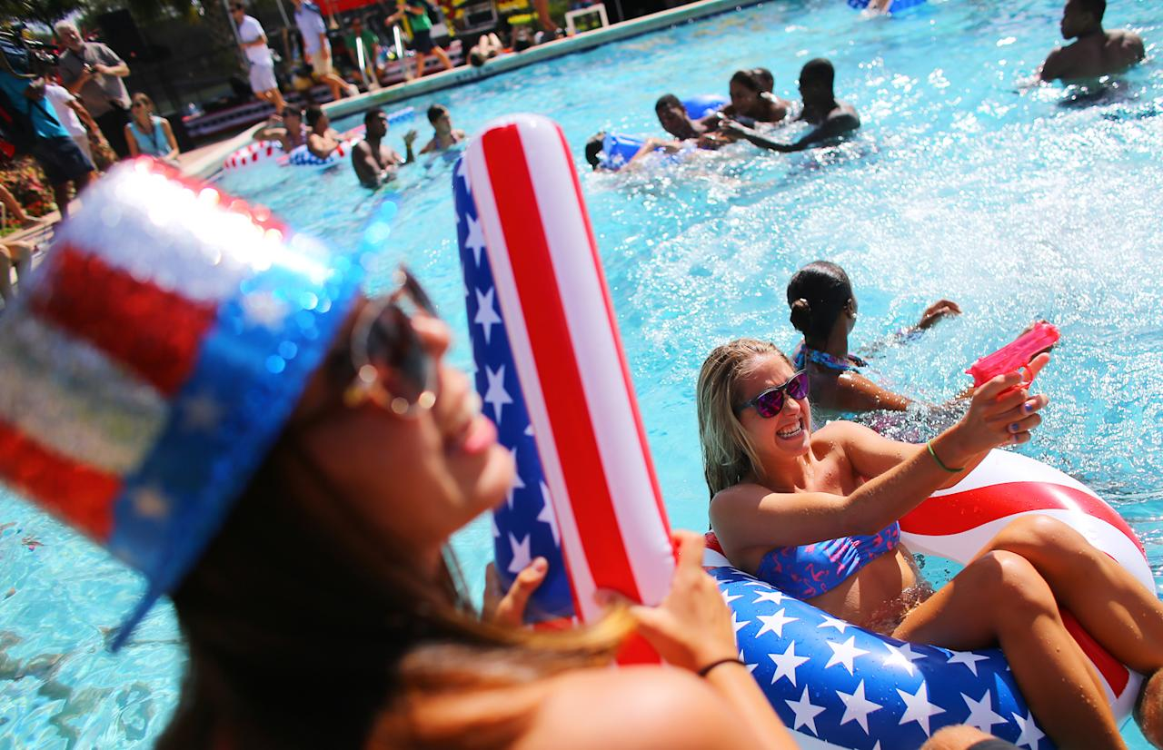 Students Shannon Anderson (L) and Megan Rodwell (R) play in the campus pool prior to the debate between U.S. President Barack Obama and Republican presidential candidate Mitt Romney at Lynn University on October 22, 2012 in Boca Raton, Florida. The final presidential debate before election day on November 6th focuses on foreign policy.  (Photo by Joe Raedle/Getty Images)