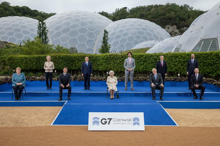 (L-R) German Chancellor Angela Merkel, European Commission Ursula von der Leyen, French President Emmanuel Macron, Japanese Prime Minister Yoshihide Suga, Queen Elizabeth II, Canadian Prime Minister Justin Trudeau, British Prime Minister Boris Johnson, Italian Prime Minister Mario Draghi, President of the European Council Charles Michel and United States President Joe Biden pose for a group photo at a drinks reception for Queen Elizabeth II and G7 leaders at The Eden Project during the G7 Summit on June 11, 2021 in St Austell, Cornwall, England.