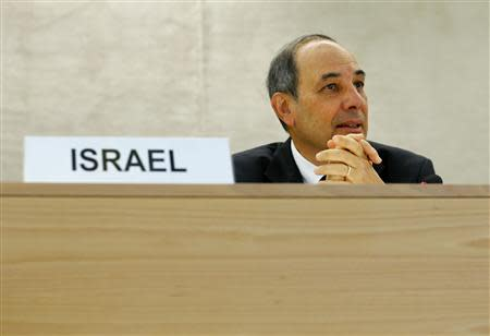 Eviatar Manor (R) Israel Ambassador to the U.N. waits for the start of the Human Rights Council Universal Periodic Review session at the European headquarters of the United Nations in Geneva October 29, 2013. REUTERS/Denis Balibouse
