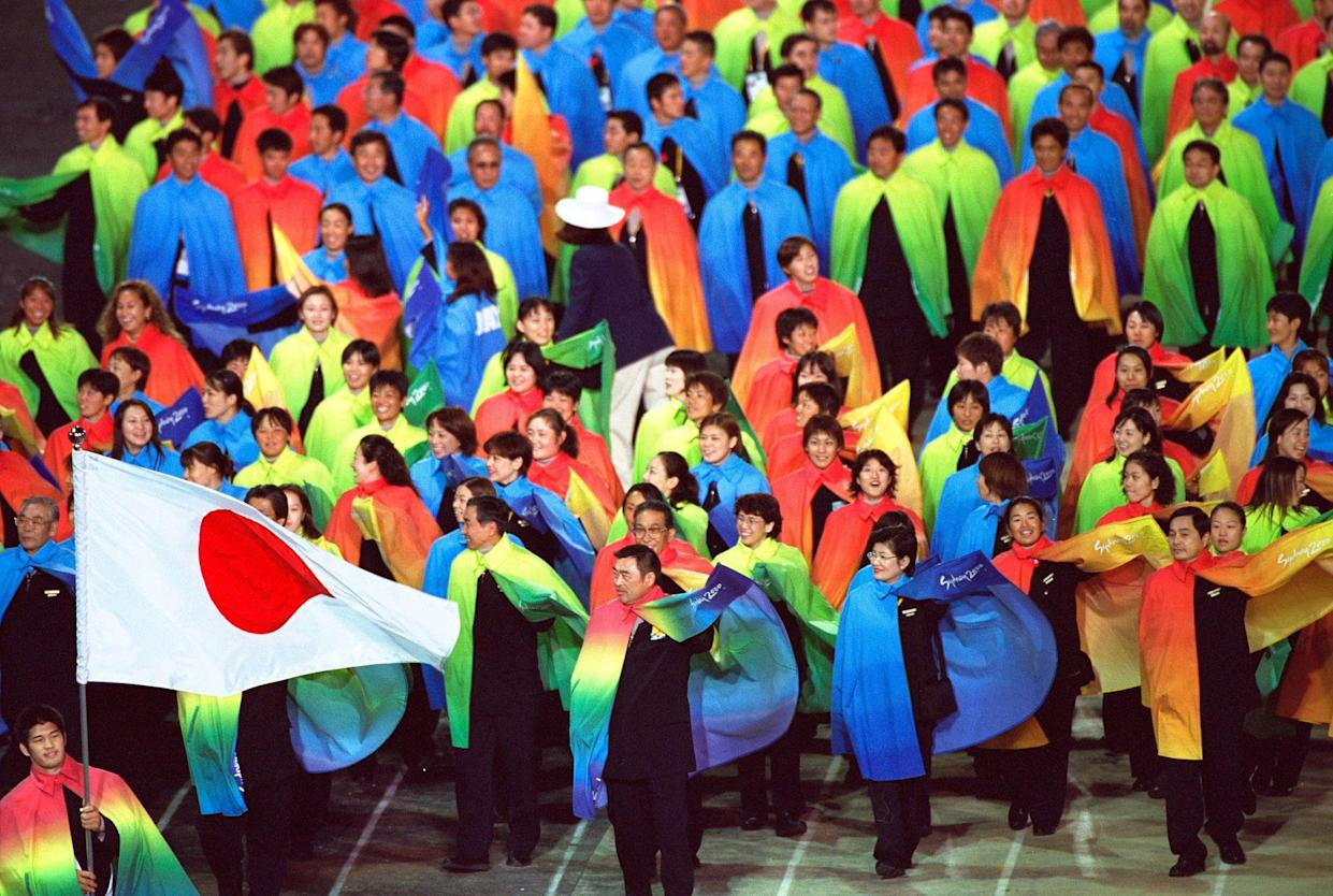 15 Sep 2000:  Flag Bearer Kosei Inoue leads team Japan during the Opening Ceremony of the Sydney 2000 Olympic Games at the Olympic Stadium in Homebush Bay, Sydney, Australia. Mandatory Credit: Clive Brunskill /Allsport