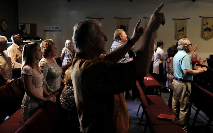 "Worshipers gather for a service at Bundy Canyon Christian Church. <span class=""copyright"">(Christina House / Los Angeles Times)</span>"