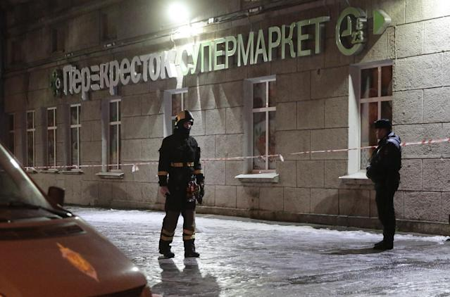 <p>An Emergency Ministry member and a policeman are seen outside a supermarket after an explosion in St. Petersburg, Russia, Dec. 27, 2017. (Photo: Anton Vaganov/Reuters) </p>