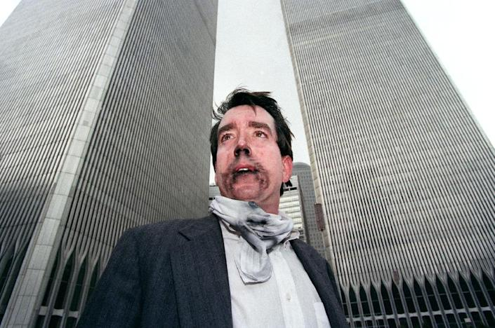 Brian Rolford stands outside the World Trade Center after walking down from the 105th floor on February 26, 1993, after a car bomb exploded in a parking garage, killing six people and injuring scores more (AFP Photo/TIMOTHY A. CLARY)