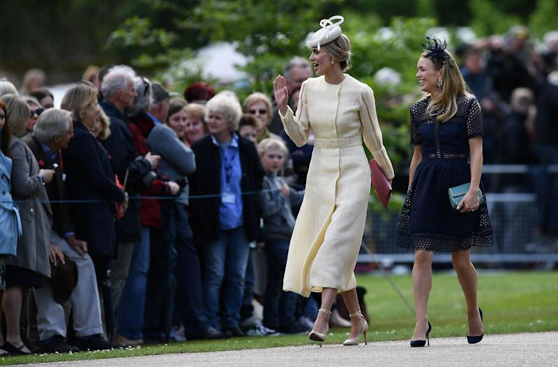 Donna Air, left, attends the wedding.
