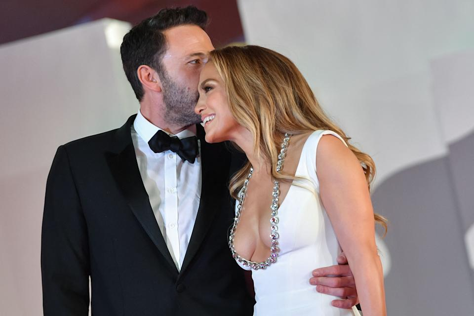 US actor Ben Affleck kisses US actress and singer Jennifer Lopez as they arrive for the screening of the film