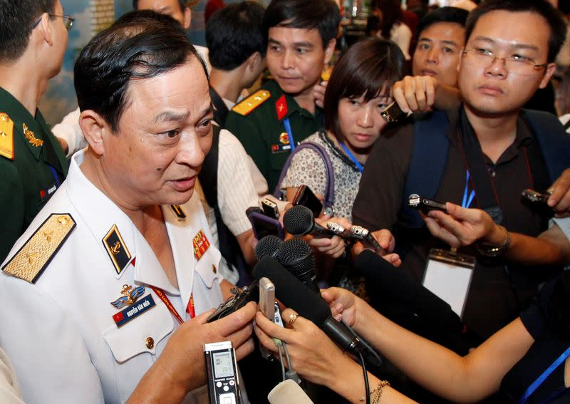 FILE PHOTO: Vietnam's Vice Minister of Defence and Navy Commander in Chief Vice Admiral Nguyen speaks with media along the sides of the 5th ASEAN Navy Chiefs meeting in Hanoi